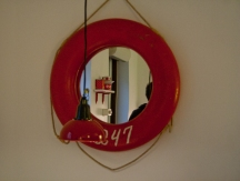 A red lifebuoy mirror in Chaika